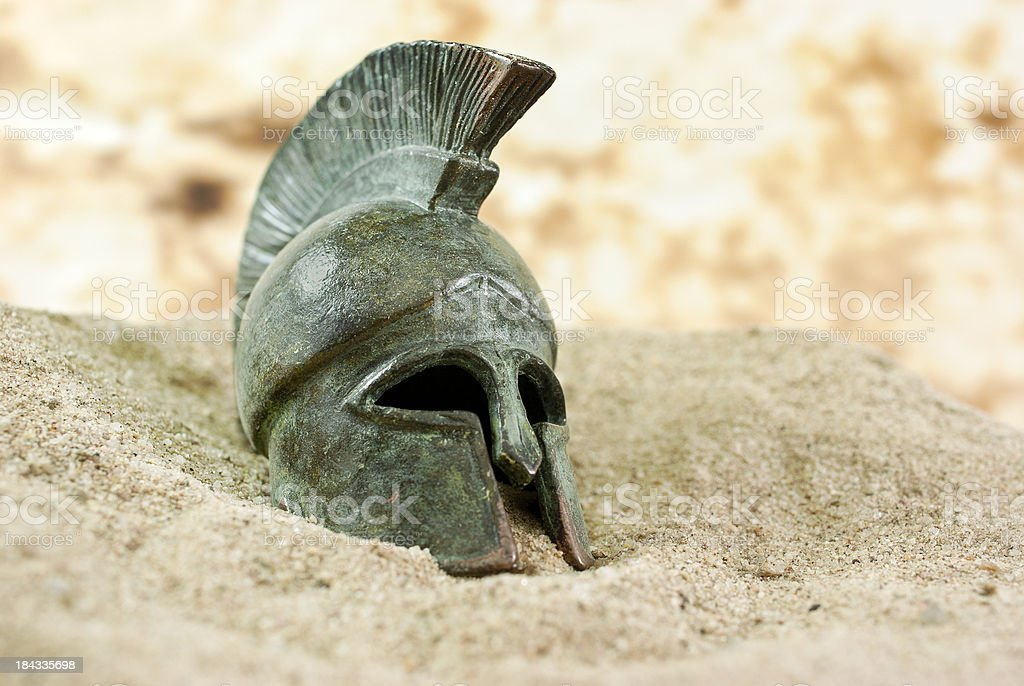 Fallen Greek helmet stock photo