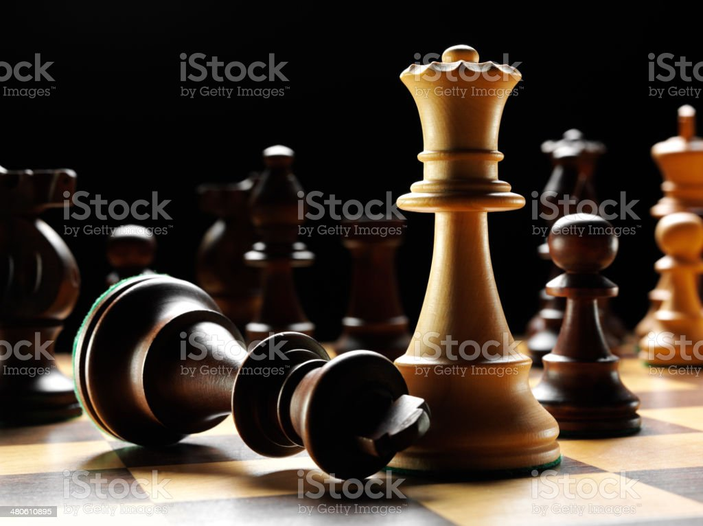 Fallen King with the Opposing Teams Chess Queen stock photo