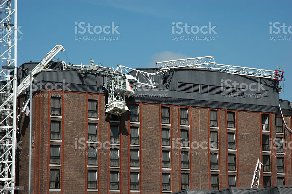 Fallen scaffolding on top of a brown building stock photo