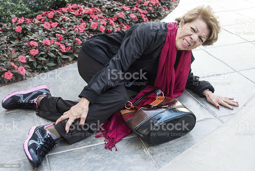 Fallen senior woman stock photo