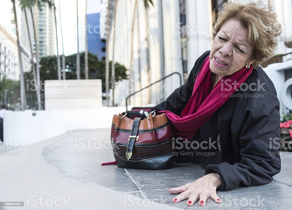 Fallen senior woman stock photo