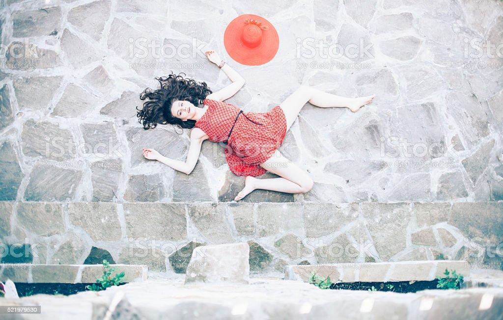 Fallen woman body lying on ground stock photo