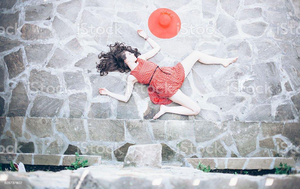 Fallen woman body lying on street stock photo