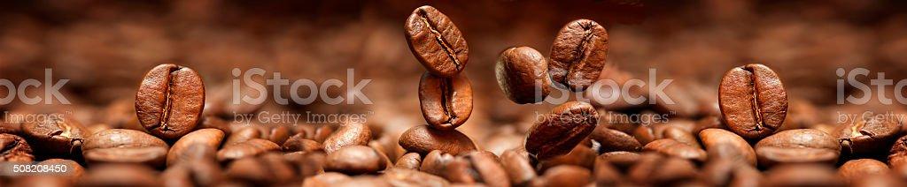 Falling coffee beans closeup stock photo