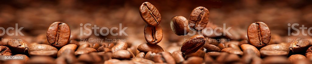 Falling coffee beans closeup stock photo