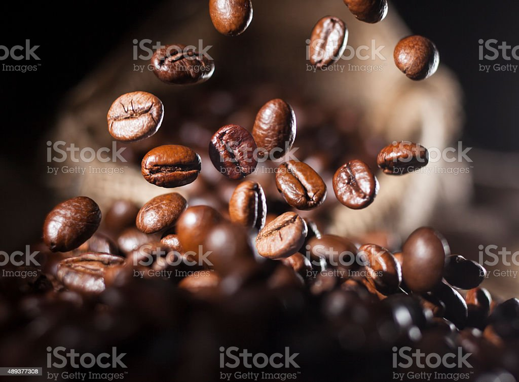 Falling coffee beans stock photo