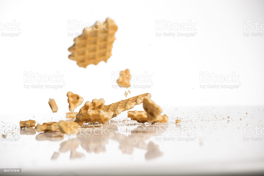 falling cookies on white background stock photo