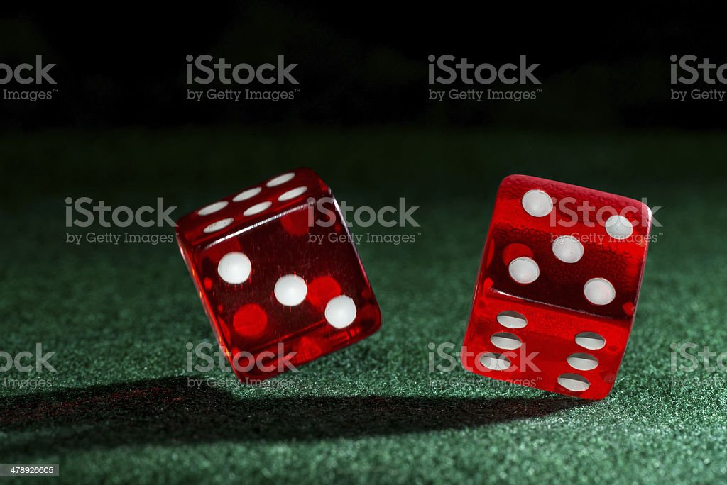 Falling dice on green felt stock photo