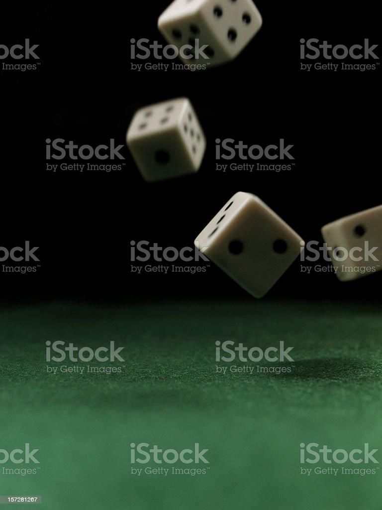 Falling Dice onto Felt Table stock photo