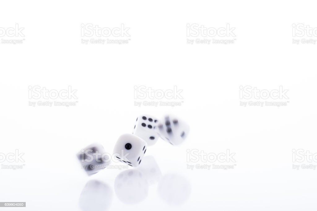 falling dices on white background stock photo