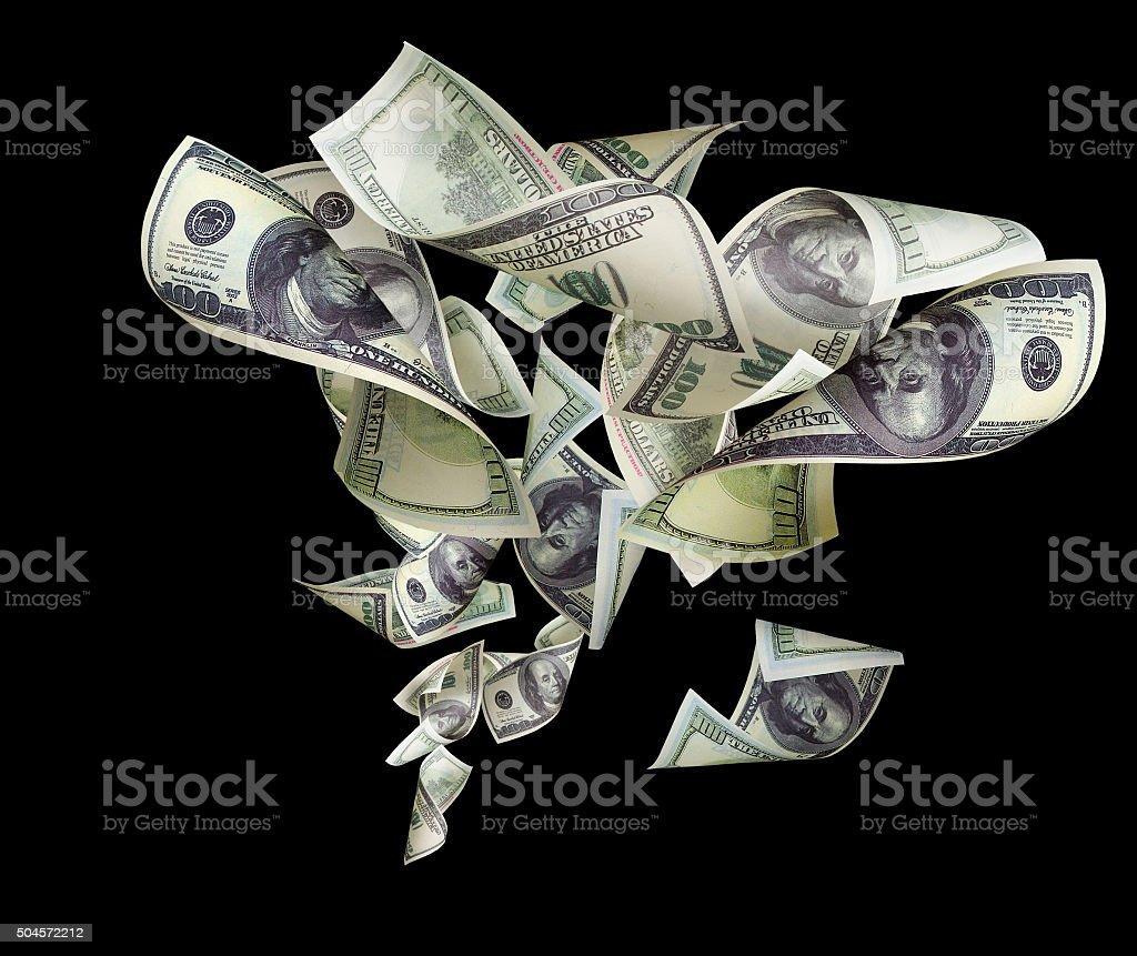 Falling dollars isolated on black background stock photo