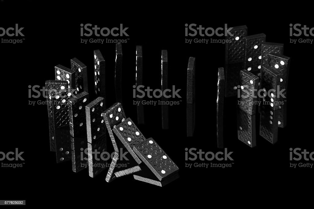 falling dominoes with a mirror image stock photo