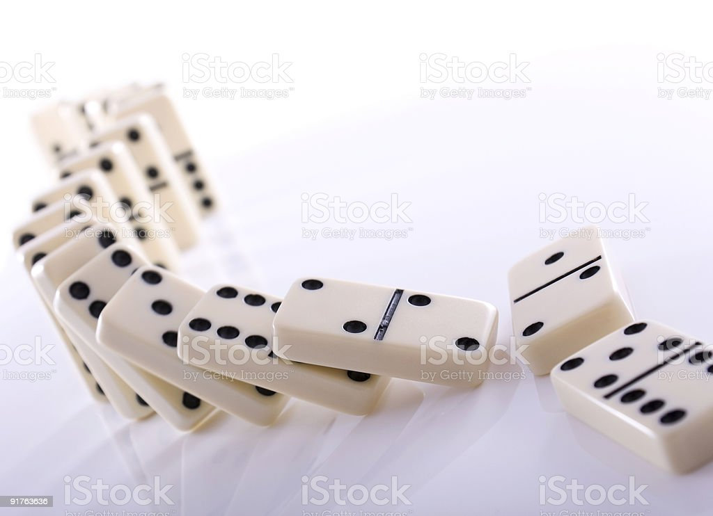 Falling dominos stock photo