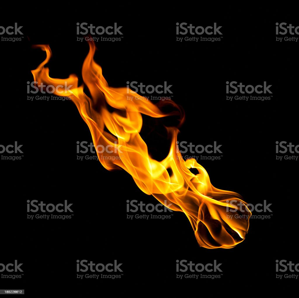 Falling fireball of hot flames isolated on black royalty-free stock photo