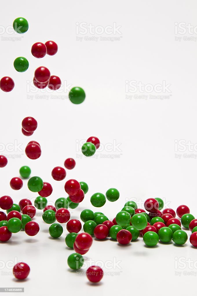 Falling green and red candy pieces royalty-free stock photo