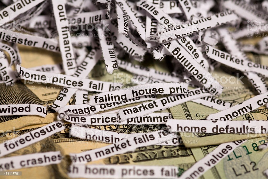 Falling home prices and economic disaster stock photo