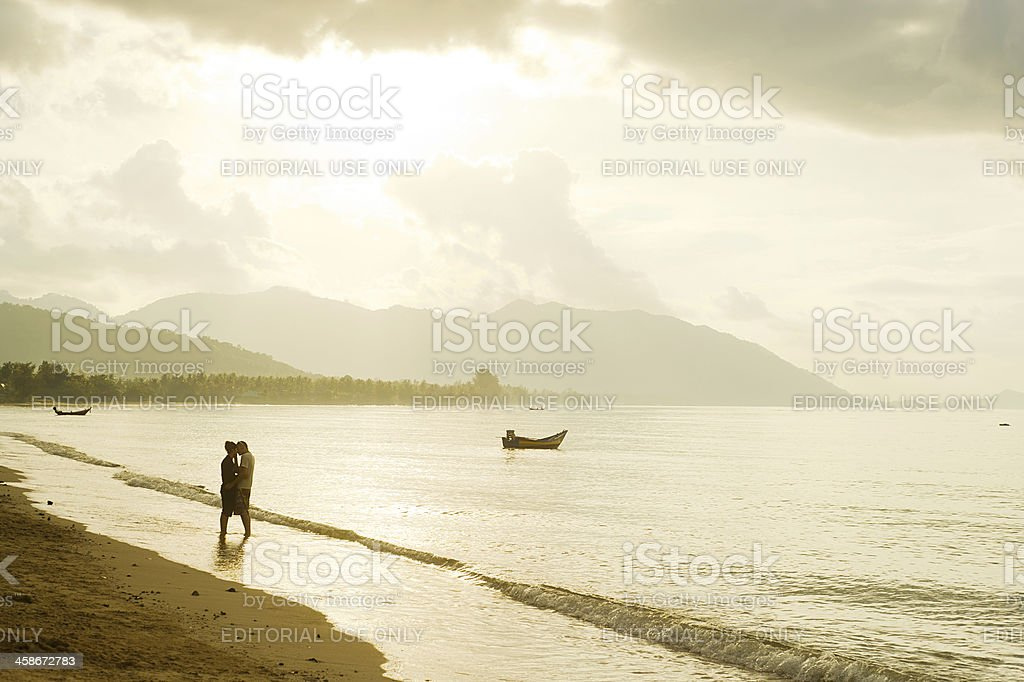 Falling in love couple on the beach royalty-free stock photo