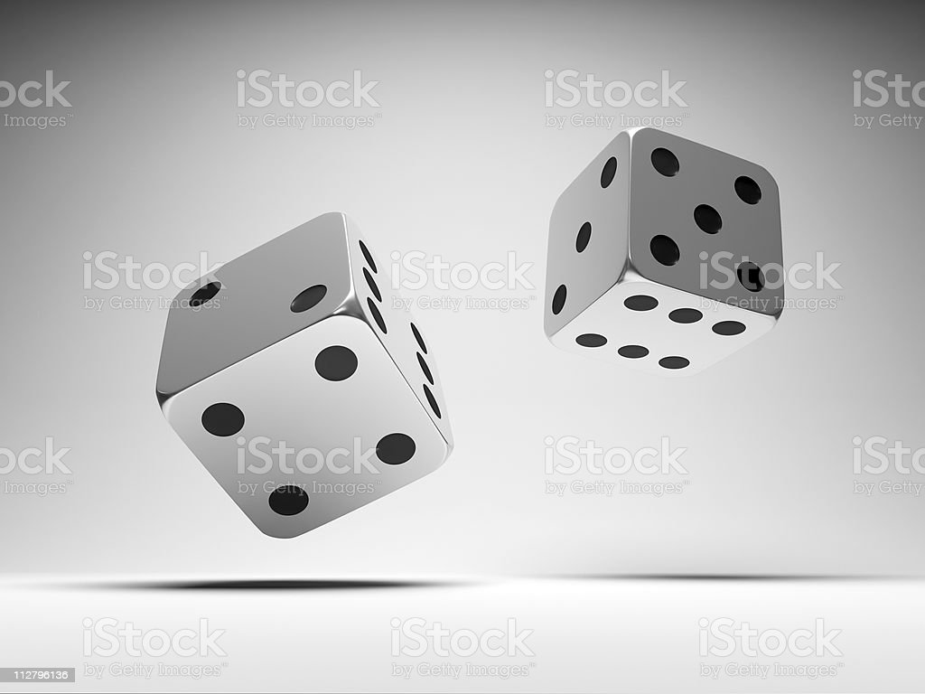 Falling metal dices stock photo