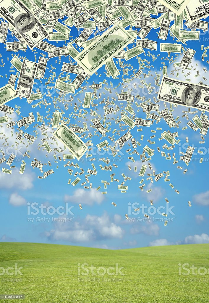 falling money over green landscape stock photo