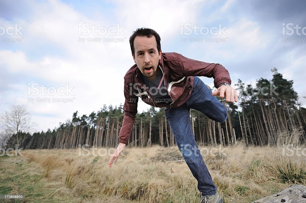 Falling off a log royalty-free stock photo