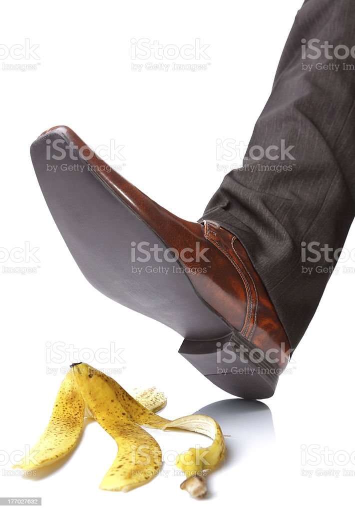 Falling on a banana skin stock photo