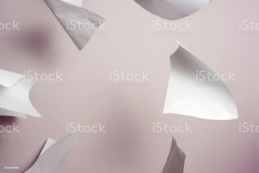 Falling paper stock photo