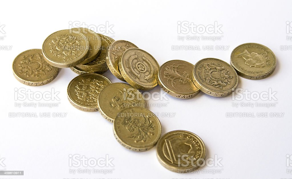 'Falling pound' - British coins falling over stock photo
