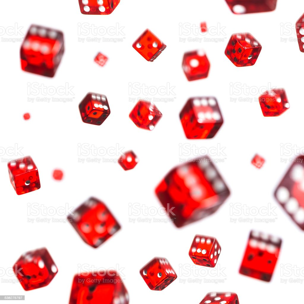 Falling red dice on white background stock photo