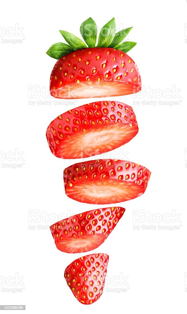 Falling sliced strawberry isolated on white stock photo