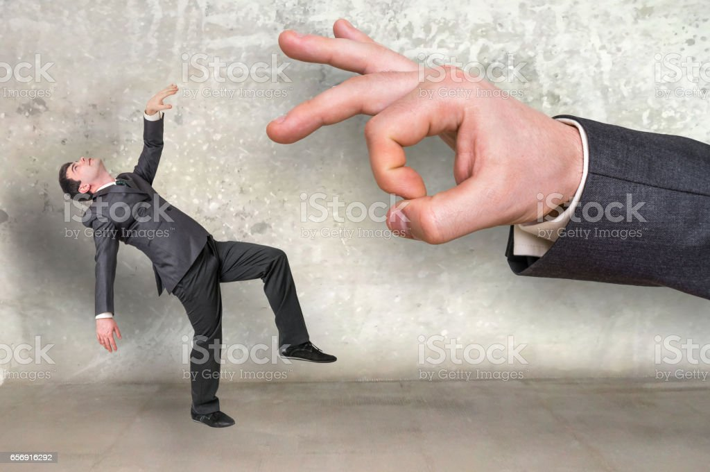 Falling small businessman and big businessman stock photo