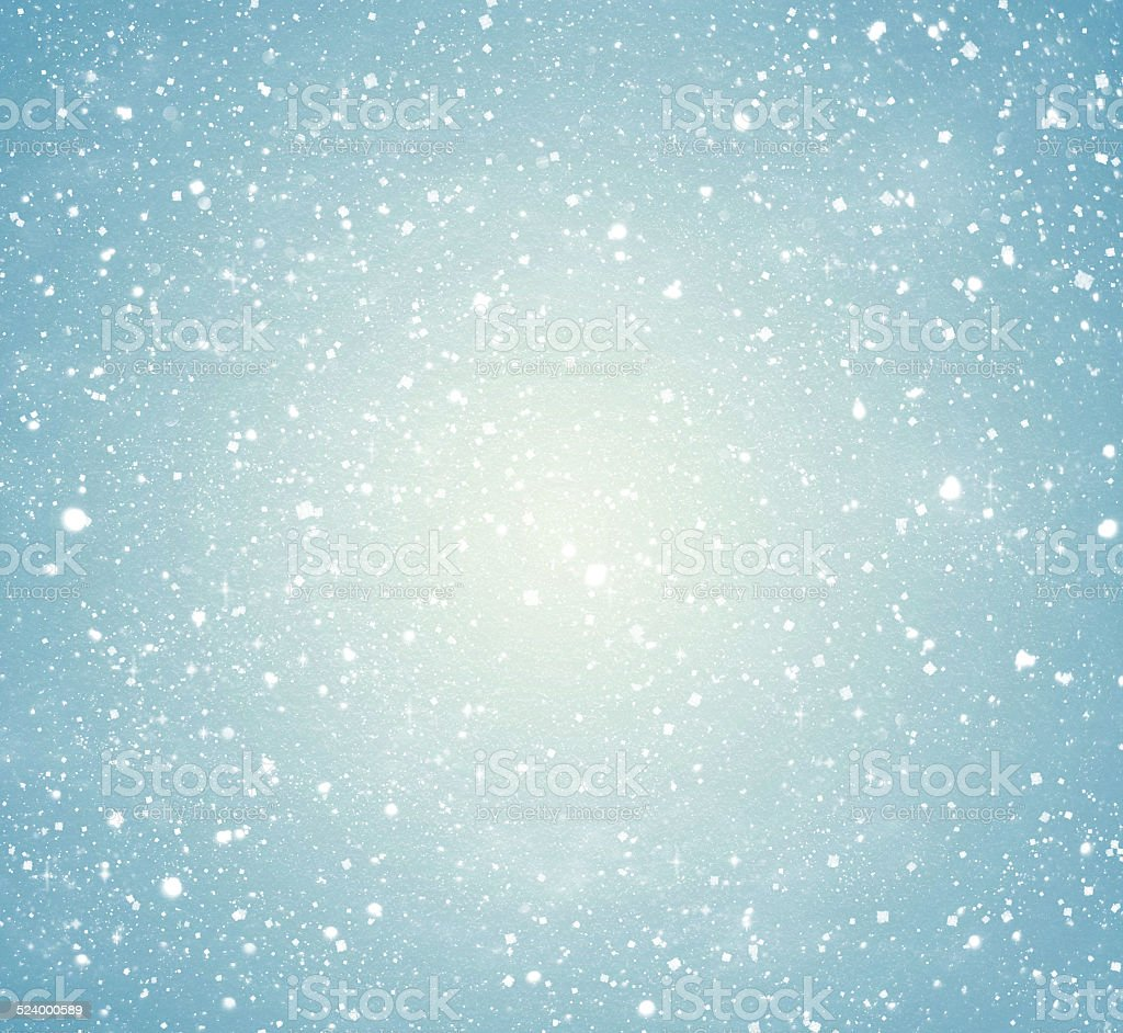 falling snow on the blue background stock photo