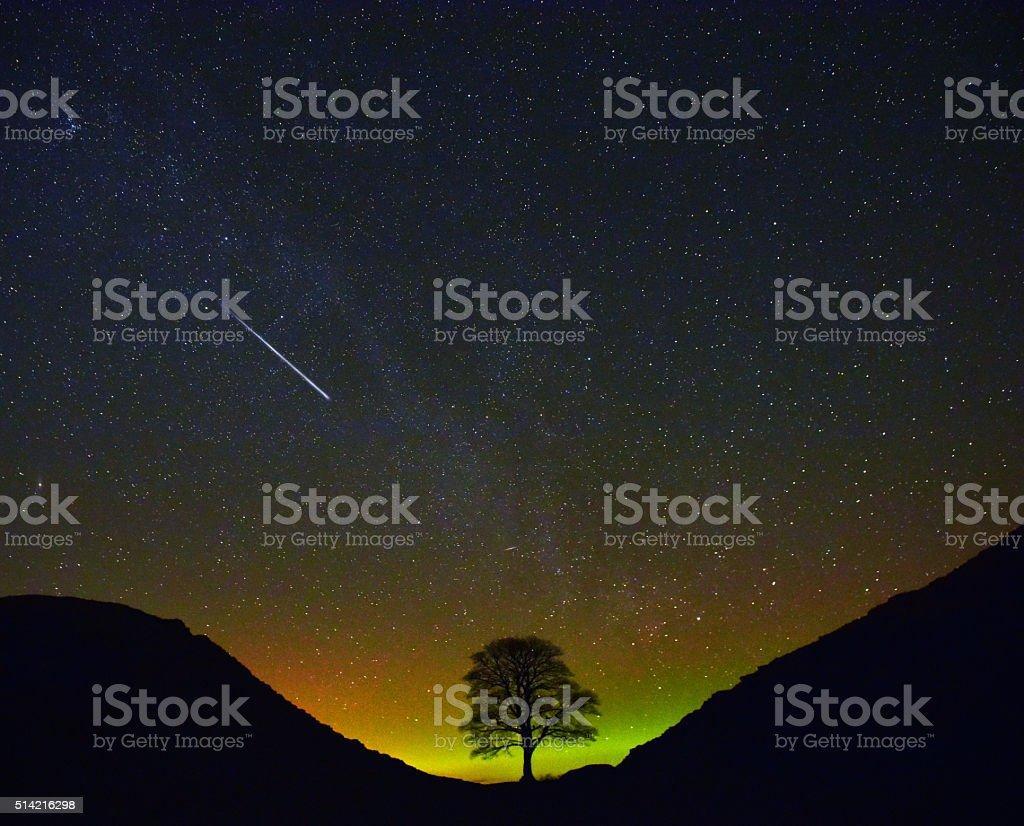 Falling Star & Aurora Borealis stock photo