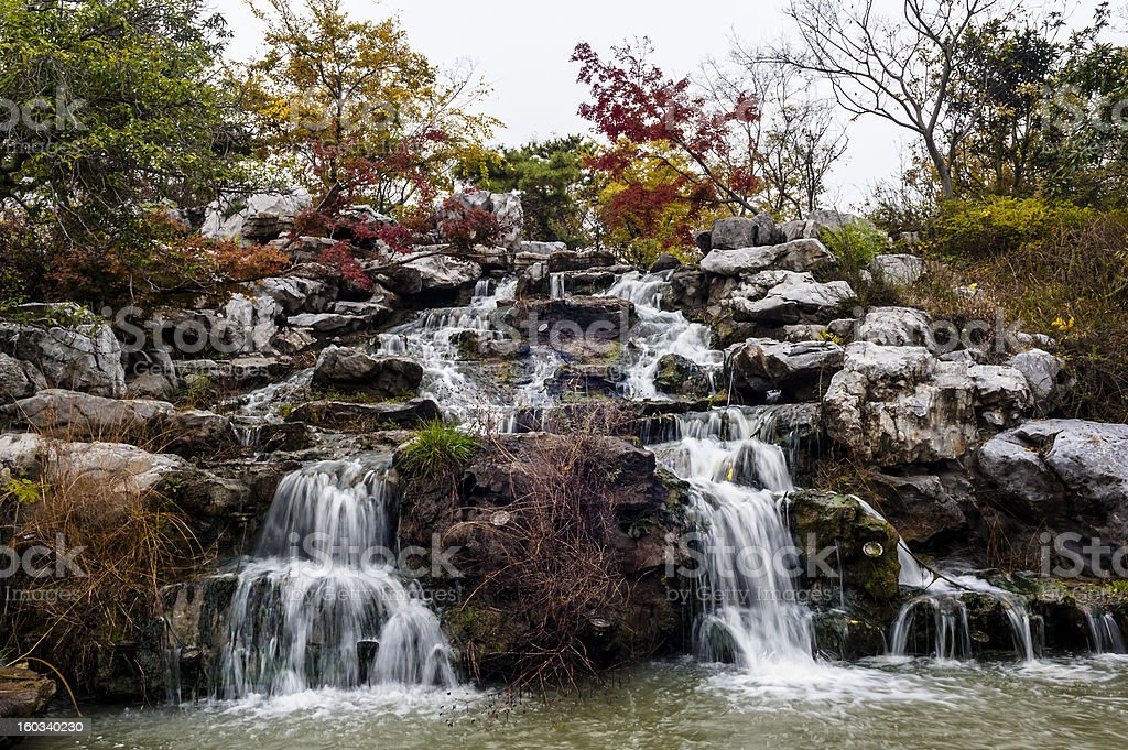 Falling stream in autumn royalty-free stock photo