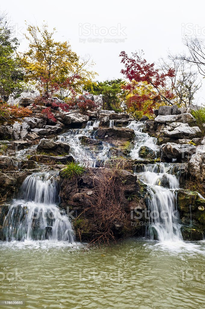 Falling stream in the golden autumn royalty-free stock photo