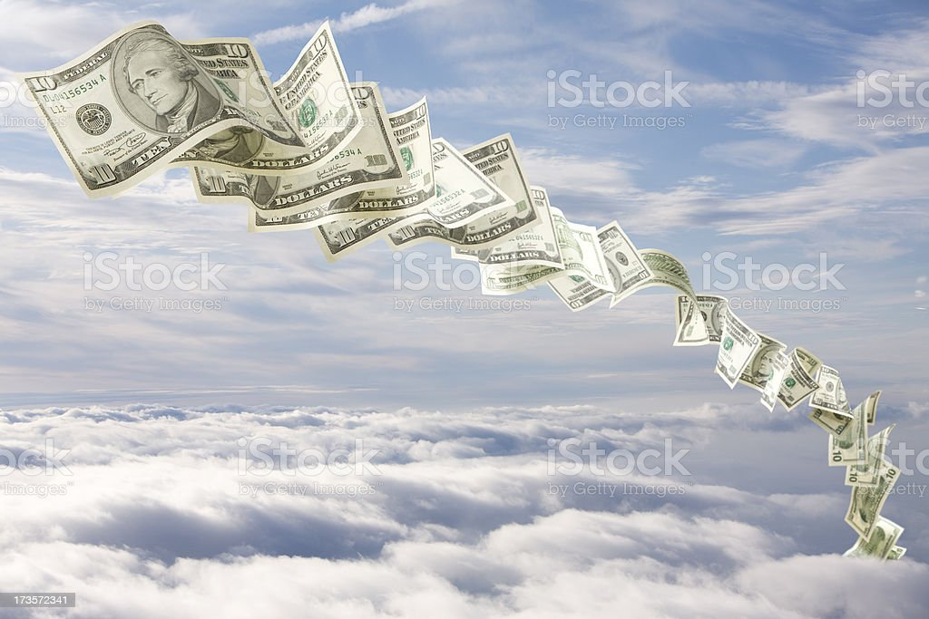 Falling ten dollars in a cloudy sky stock photo