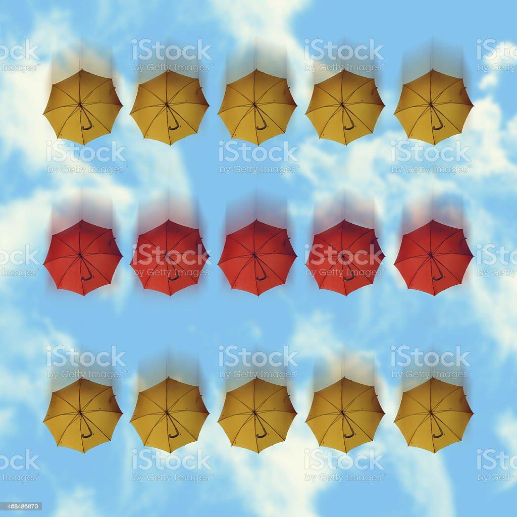 Falling umbrellas stock photo