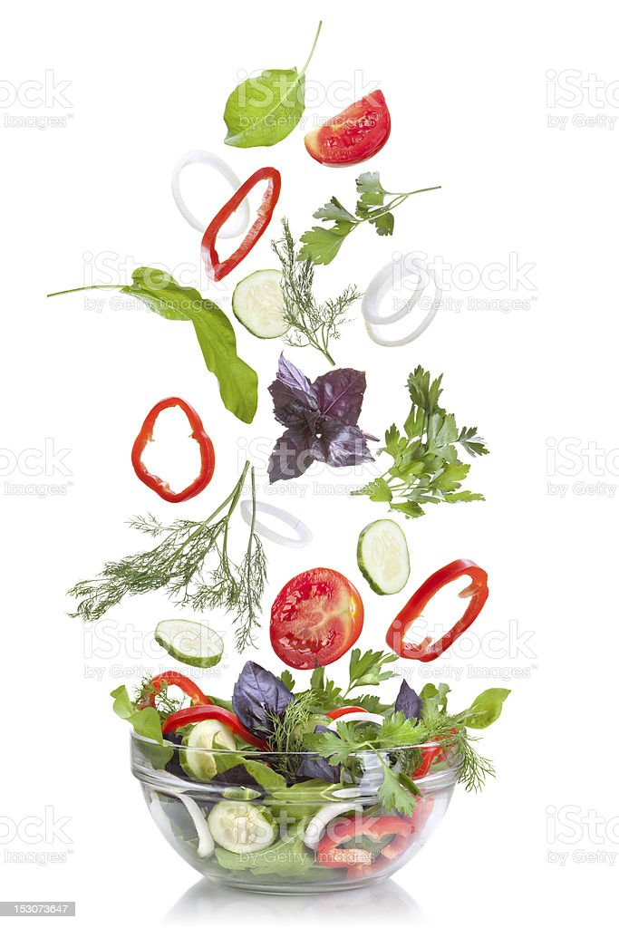 Falling vegetables for salad isolated on white stock photo