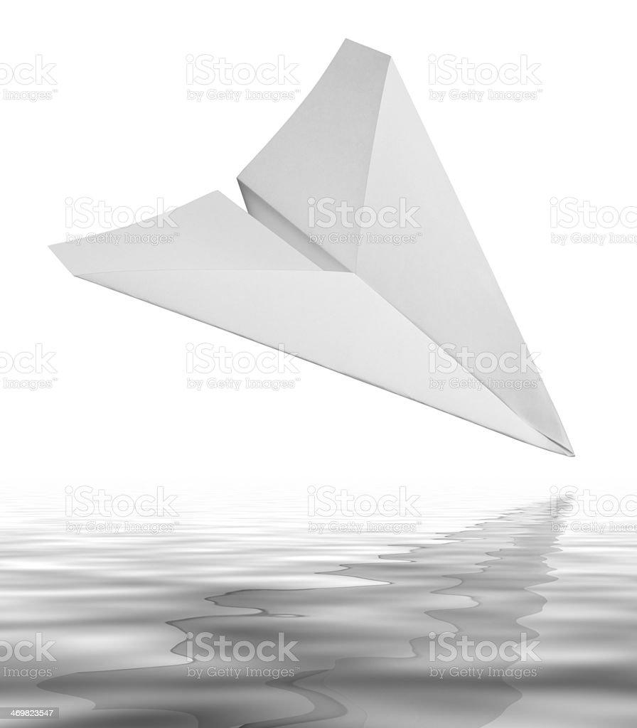 falling white paper plane stock photo