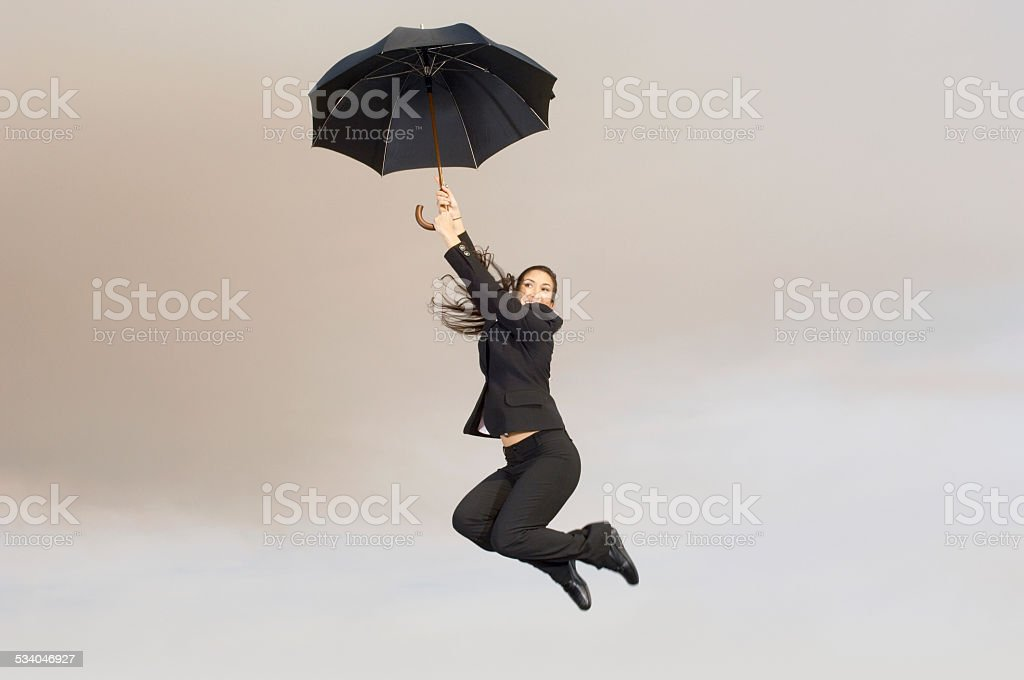 Falling Woman with Umbrella stock photo