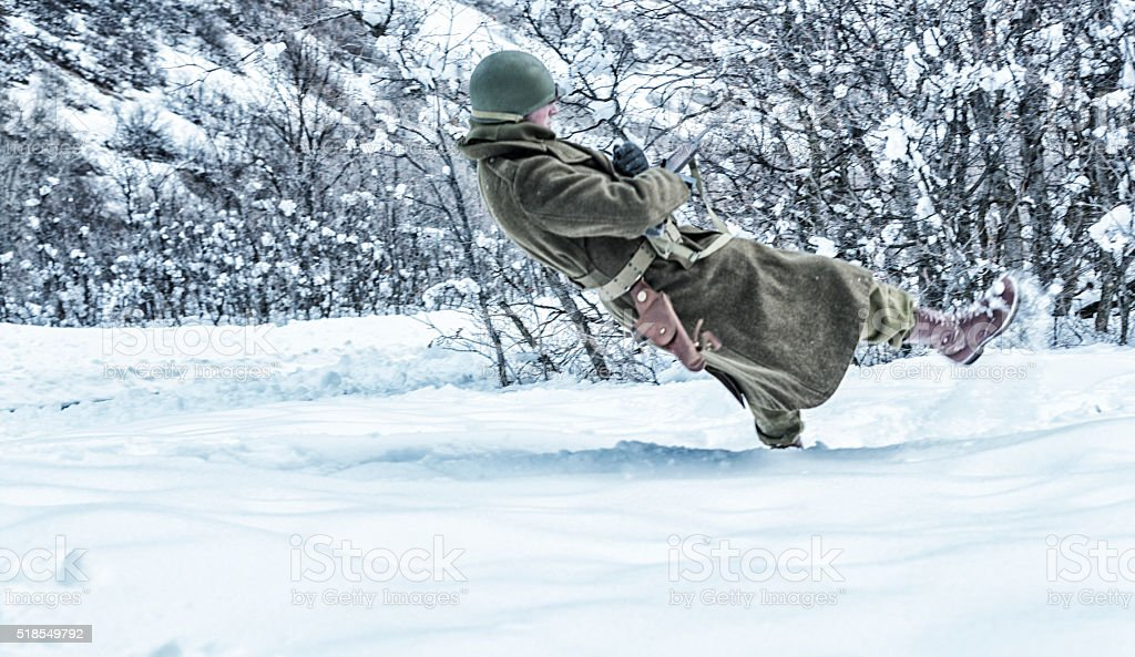 Falling WWII US Army Combat Soldier Shot By Enemy Ambush stock photo
