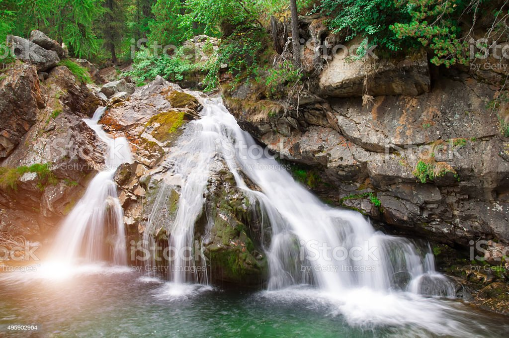 falls of a little river in the mountain of italy stock photo