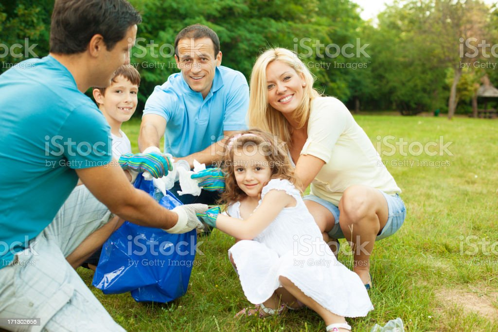 Familes Picking Up Litter royalty-free stock photo