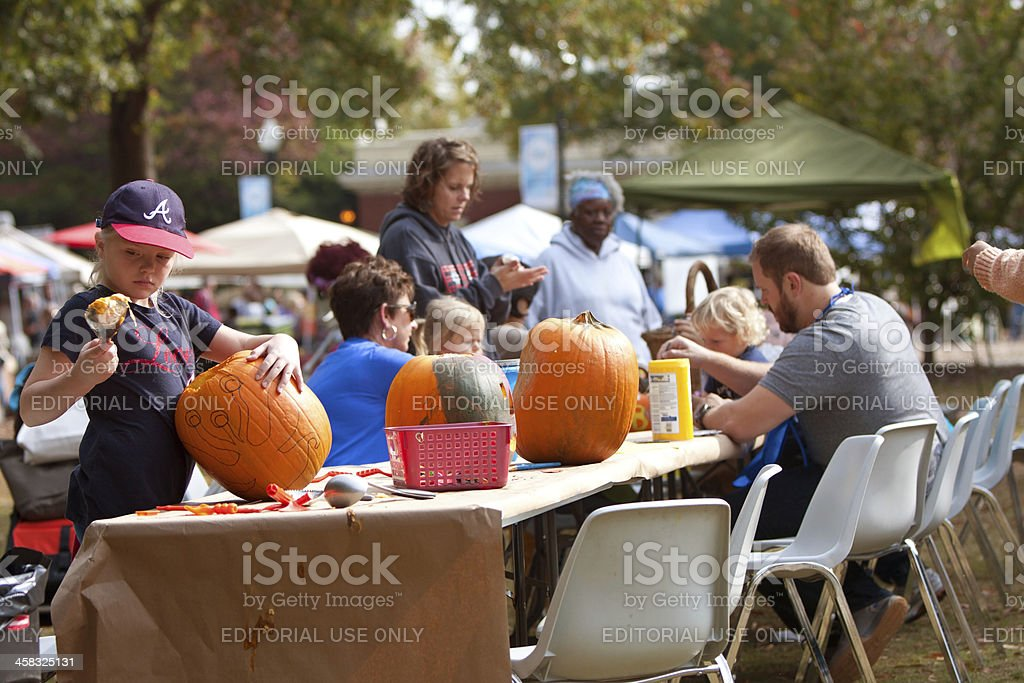 Families And Children Carve Halloween Pumpkins royalty-free stock photo