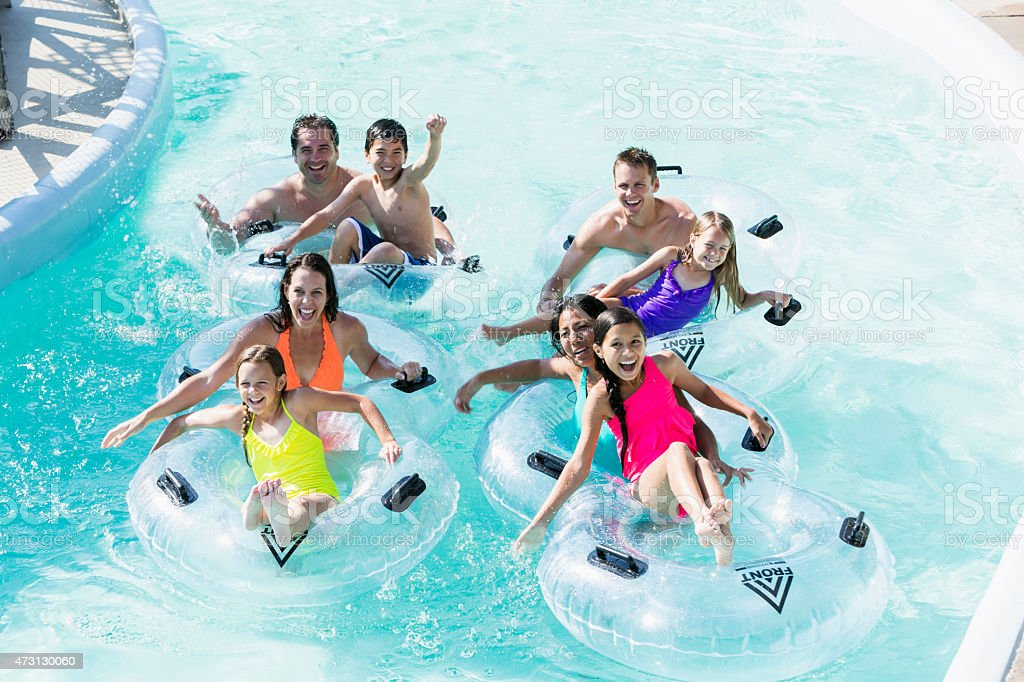Families and friends at water park stock photo