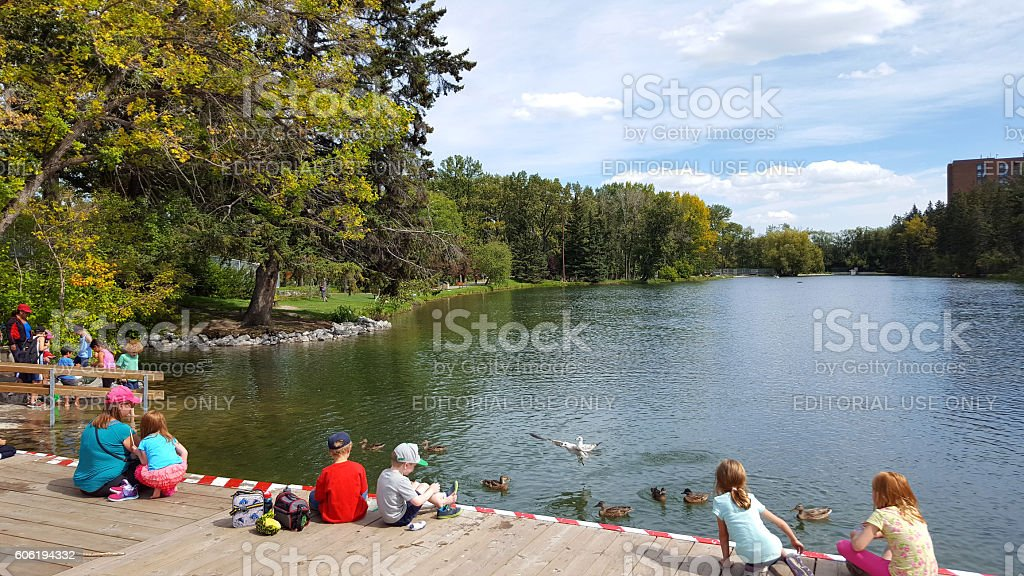 Families And Kids Enjoying Waterside Nature stock photo