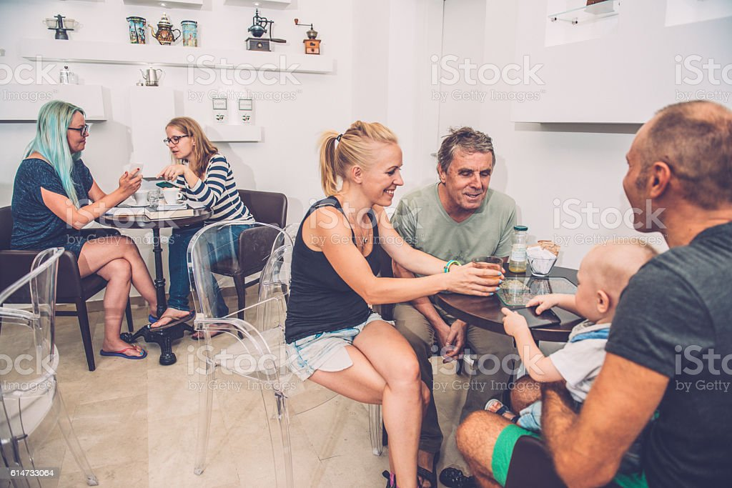 Families and Students at Coffee Bar Cafe Trieste, Europe stock photo