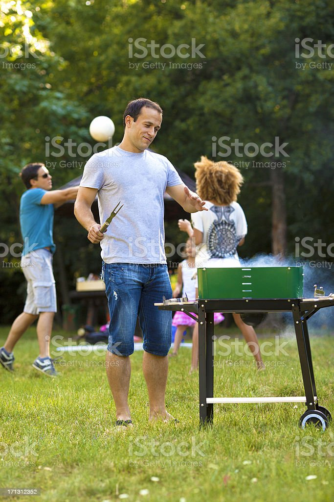 Families at barbecue picnic. royalty-free stock photo