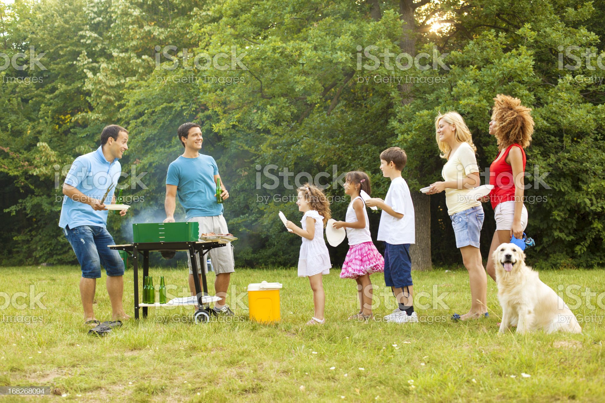 Families enjoying a barbecue. royalty-free stock photo