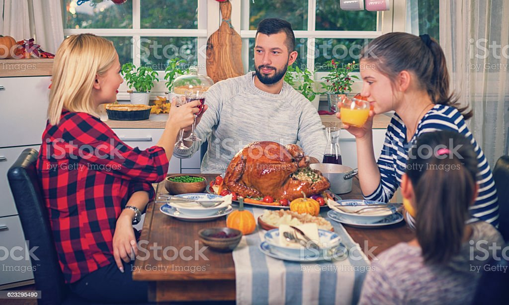 Families Have a Traditional Holiday Dinner stock photo