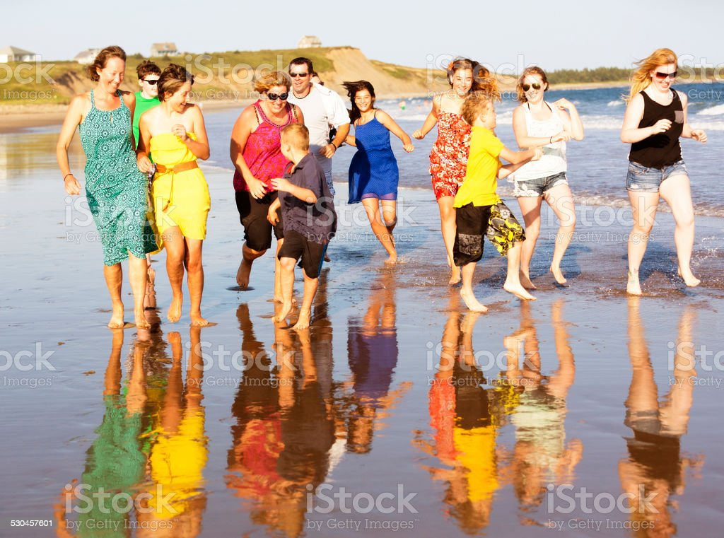Families Running on the Beach stock photo